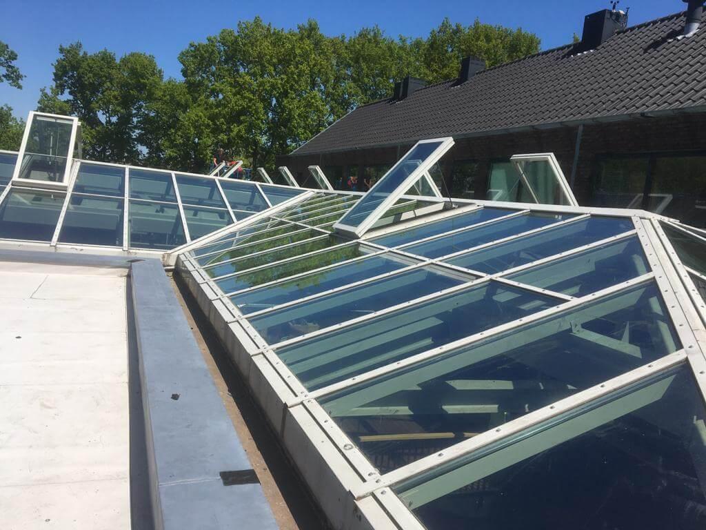 Onderhoud glazen dak zijaanzicht